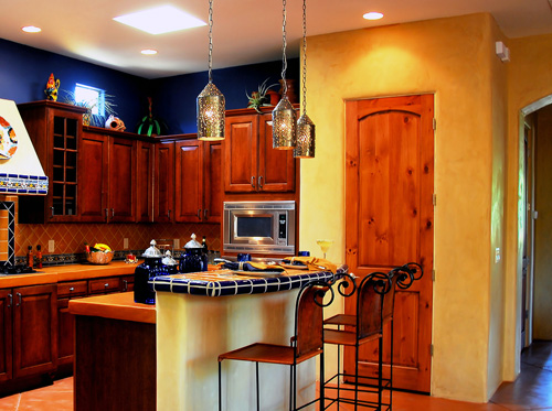 Kitchen with drop down and recessed lighting